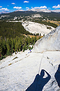 Rock climber on Marmot Dome, Tuolumne Meadows, Yosemite National Park, California USA