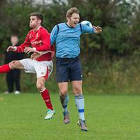 Newmarkets Eoin O'Brien and Avondales Pat McCarthy leap to head the ball