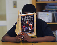 Minneapolis , MN -  April 29, 2015 -  A student reads his Hip Hop Street Curriculum book during the Black Male Achievement Class at Nellie Stone Johnson Community School on Wednesday, April 29, 2015. Photo by Johnny Crawford/ Johnny Crawford Photography