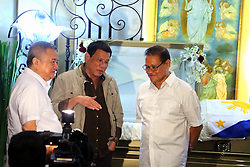 October 2, 2016 - Philippines - President Rodrigo Duterte (center) visited the wake and assisted by Jun Santiago (husband of Sen. Santiago, left) and the Sen. Brother (right) during the wake of Sen. Miriam Defensor Santiago at Immaculate Conception Cathedral in Quezon City. Sen. Santiago pass-away last September 29, 2016 due to her stage 4 lung cancer and she is one of the candidates for presidential election 2016. (Credit Image: © Gregorio B.Dantes Jr/Pacific Press via ZUMA Wire)