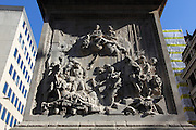 Detail on the bottom of the Monument, in the City of London. It is a monument to the Great Fire of London in 1666 and was designed by Sir Christopher Wren