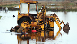 © Licensed to London News Pictures. 02/02/2014. Burrowbridge, UK A vehicle sits in floodwater. Burrowbridge on the Somerset levels today. The River Parrett broke its banks again at 9.15 am today 2nd February 2014. Photo credit : Jason Bryant/LNP
