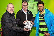 Forest Green Rovers Kaiyne Woolery(14) with the match ball sponsors Glevum Security during the Vanarama National League match between Forest Green Rovers and Chester FC at the New Lawn, Forest Green, United Kingdom on 14 April 2017. Photo by Shane Healey.