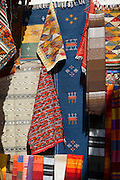 Textiles for sale at a shop in the medina of Essaouira in Morocco