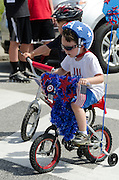 BAR HARBOR, MAINE, July 4, 2014. Young riders have decorated their bicycles for the Independence Day Parade