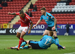 Charlton Athletic's Josh Magennis (left) is tackled by Fleetwood Town's Can Bolger