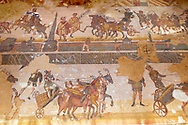 Chariot racing at the Circus Maximus Chariot racing at the Circus Maximus from the Palaestra room no 15.. Roman mosaics at the Villa Romana del Casale which containis the richest, largest and most complex collection of Roman mosaics in the world. Constructed  in the first quarter of the 4th century AD. Sicily, Italy. A UNESCO World Heritage Site. .<br /> <br /> If you prefer to buy from our ALAMY PHOTO LIBRARY  Collection visit : https://www.alamy.com/portfolio/paul-williams-funkystock/villaromanadelcasale.html<br /> Visit our ROMAN MOSAIC PHOTO COLLECTIONS for more photos to buy as buy as wall art prints https://funkystock.photoshelter.com/gallery/Roman-Mosaics-Roman-Mosaic-Pictures-Photos-and-Images-Fotos/G00008dLtP71H_yc/C0000q_tZnliJD08