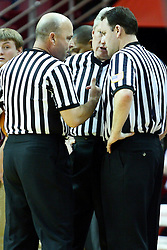 12 February 2011: Referees Erick Curry, Brad Gaston and David Maracich talk over an intentional foul after reviewing the play on a monitor during a timeout during an NCAA Missouri Valley Conference basketball game between the Missouri State Bears and the Illinois State Redbirds at Redbird Arena in Normal Illinois.
