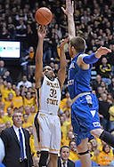 WICHITA, KS - JANUARY 18:  Guard Tekele Cotton #32 of the Wichita State Shockers shoots against forward Justin Grant #5 of the Indiana State Sycamores during the first half on January 18, 2014 at Charles Koch Arena in Wichita, Kansas.  (Photo by Peter G. Aiken/Getty Images) *** Local Caption *** Tekele Cotton;Justin Grant