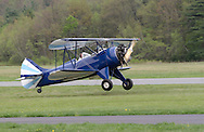 Wurtsboro, NY - A 1941 Waco UPF-7 biplane lands during the grand reopening of Wurtsboro Airport on May 11, 2008.