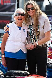 Hall-of-Famers nonagenarian Gloria Struck and motorcycle themed writer Cris Simmons at the Hall of famers nonagenarian Gloria Struck with longtime friend Cris Simmons. Perewitz Paint Show at the Iron Horse Saloon during the Sturgis Black Hills Motorcycle Rally. SD, USA. Wednesday, August 7, 2019. Photography ©2019 Michael Lichter.