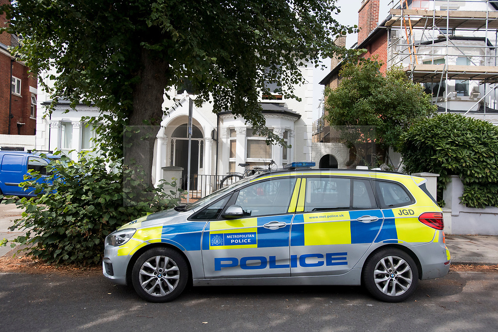 © Licensed to London News Pictures. 16/08/2020. London, UK. A police car at the scene at Cumberland Park in Acton, West London where 10 year old boy was discovered dead after a woman handed herself in to police at a nearby station. . Photo credit: Ben Cawthra/LNP