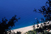 Raised view of blue sea and beach of the Turquoise Coast at Olu Deniz, Fethiye, Turkey