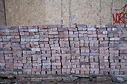 Pile of bricks outside a shop undergoing renovation on 29th December 2020 in Birmingham, United Kingdom.