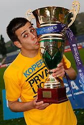Mitja Viler of Koper celebrates with a Trophy  after the football match between NK Nafta Lendava and NK Luka Koper of PrvaLiga league on May 16, 2010 in Lendava, Slovenia. Nafta lost 1 : 2, Koper became National champion.  (Photo by Urban Urbanc / Sportida)