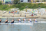 Linz. AUSTRIA.    Men's Quadruple sculls Semi Final 2,  GBR BM4X,[ Jack Beaumont/Barnaby Stentiford/Marcus Bowyer/Angus Groom] sculling to the line to qualify for Sundays final at the FISA U23 World Championships, Linz-Ottensheim Rowing Course.  10:36:40  Saturday  27/07/2013. [Mandatory Credit, Peter Spurrier/ Intersport Images] ,