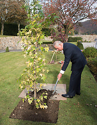 The Prince of Wales plants a tree at the Aberfan Memorial Garden in Aberfan, Wales on the 50th anniversary of the tragedy.