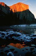 Sunset on El Capitan in Yosemite National Park reflected in the Merced River.