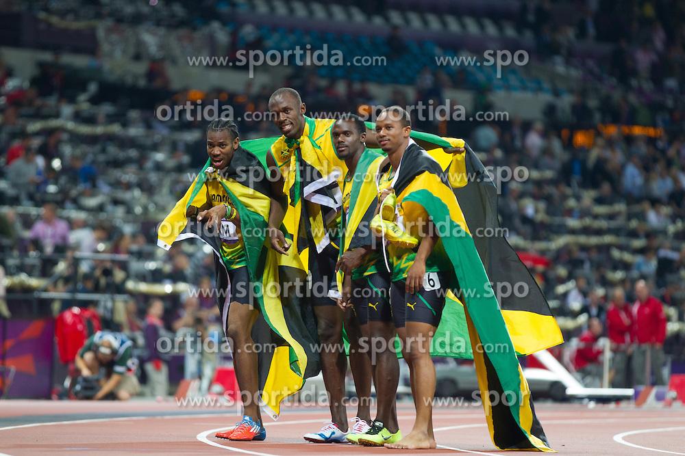 11.08.2012, Olympia Stadion, London, GBR, Olympia 2012, 4 x 100m Staffel, Herren, Finale, im Bild Team Jamaica Nesta Carter (JAM), Michael Frater (JAM), Yohan Blake (JAM), Usain Bolt (JAM) // Team Jamaica Nesta Carter (JAM), Michael Frater (JAM), Yohan Blake (JAM), Usain Bolt (JAM) after Men's 4 x 100m Relay Final at the 2012 Summer Olympics at Olympic Stadium, London, United Kingdom on 2012/08/11. EXPA Pictures © 2012, PhotoCredit: EXPA/ Johann Groder#