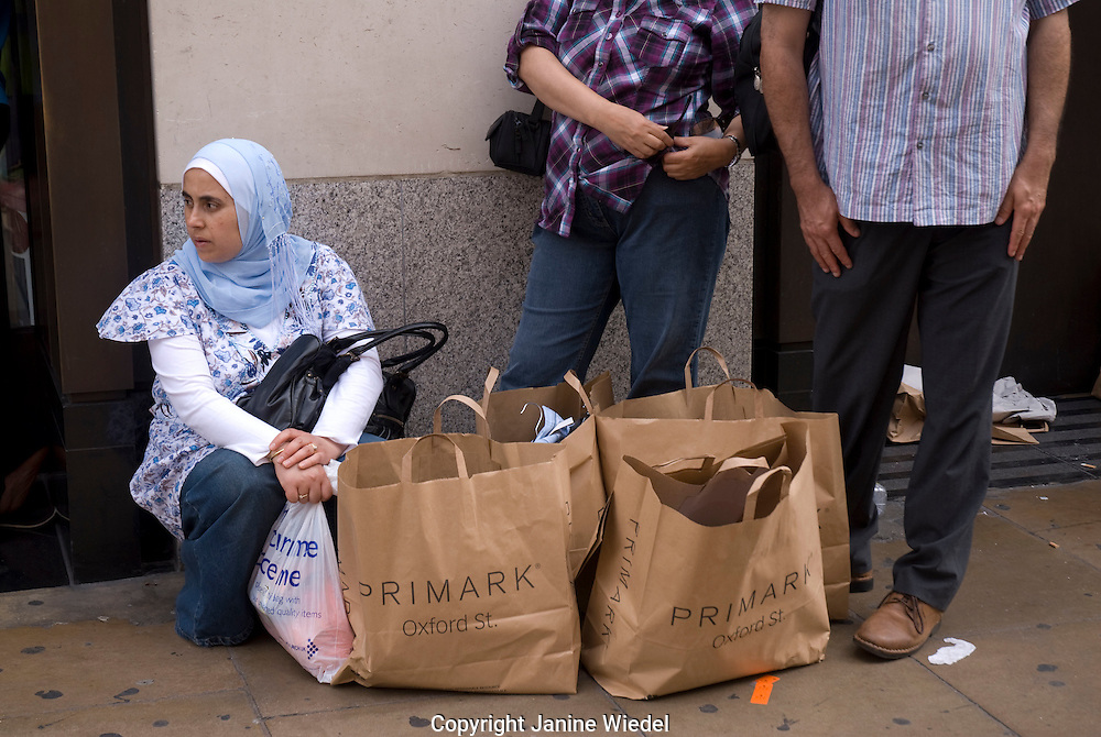 Shoppers waiting outside of primark shop Oxford Street London