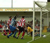 Photo Aidan Ellis, Digitalsport<br /> NORWAY ONLY<br /> <br /> Lincoln City v Huddersfield Town.<br /> Third Divison Play Off Semi Final 1st leg.<br /> 15/05/2004.<br /> Huddersfield's David Mirfin (blocked) scores the winning goal