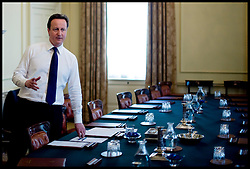 The Prime Minister David Cameron working in the Cabinet room on his first day in office, Downing Street, London, UK, Wednesday May 12, 2010. Photo By Andrew Parsons / i-Images.
