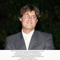 COLIN TWEEDY Chief Executive of Arts & Business, at a party in London on 12th September 2003.PMJ 90