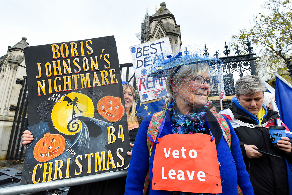 © Licensed to London News Pictures. 30/10/2019. LONDON, UK.  Anti-Brexit protesters with Halloween inspired signs and flags outside the Houses of Parliament. Photo credit: Stephen Chung/LNP