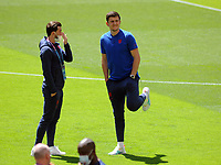 Football - 2021 EUFA European Championships - Finals - Group D - England vs Croatia, Wembley Stadium<br /> <br /> Harry Maguire of England lifts up his injured leg while talking to Ben Chilwell<br /> <br /> Credit : COLORSPORT/Andrew Cowie