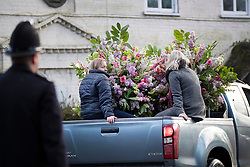 © Licensed to London News Pictures. 27/02/2017. Dummer, UK. A pickup truck is used to remove floral arrangements from All Saints' Church after a memorial service for Tara Palmer Tomkinson in Dummer, Hampshire.  Tara, 45, was found dead in her home in south west London on February 8. Her older sister said that 'Tara Clare died peacefully in her sleep on February 8th 2017. Photo credit: Peter Macdiarmid/LNP