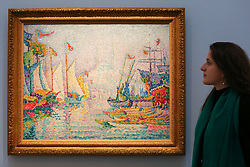 © Licensed to London News Pictures. 29/01/2020. London, UK. A staff member views Paul Signac's painting titled La Coene d'Ot, matin (est £5m to £7m) at the preview of Sotheby's Impressionist, Modern and Surrealist art sales. The auction will take place at Sotheby's in central London on 4 and 5 February 2020. Photo credit: Dinendra Haria/LNP