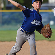 A young pitcher in action during the Norwalk Little League baseball competition at Broad River Fields,  Norwalk, Connecticut. USA. Photo Tim Clayton