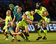 Sale Sharks stand-off AJ McGinty breaks through Irish tackles during the The Aviva Premiership match Sale Sharks -V- London Irish  at The AJ Bell Stadium, Salford, Greater Manchester, England on September 15, 2017. (Steve Flynn/Image of Sport)