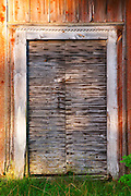Traditional style Swedish wooden painted house. A door Fading peeling painting. Smaland region. Sweden, Europe.