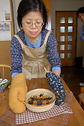 """Chisato Uchiyama serves up Taiwanese water bugs with Japanese udon noodles. Tokyo resident Shoichi Uchiyama is the author of """"Fun Insect Cooking"""". His blog on the topic gets 400 hits a day. He believes insects could one day be the solution to food shortages, and that rearing bugs at home could dispel food safety worries."""