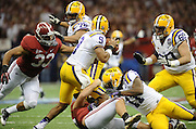 Daily Photo by Gary Cosby Jr.    ..Trey DePriest and Nick Gentry sack Jordan Jefferson during the second half of the BCS National Championship Game between Alabama and LSU in the Superdome Monday night...................................