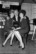 19/01/1963<br /> 01/19/1963<br /> 19 January 1963<br /> Lord mayor draws raffle prizewinner at Mansion House, Dublin.  At the conclusion of the Irish Hotel and Catering Trades Exhibition at the Mansion House, Lord Mayor Alderman J.J. O'Keeffe, T.D., P.C. drew the winning ticket in aid of the Royal Hospital for Incurables, Donnybrook, Dublin for a Lanson Black Label Methuselah, presented by Edward Dillon and Co. Ltd. The proceeds of £50 were presented to the Mayor for donation to the hospital. Picture shows the Lord Mayor congratulating the two Dublin models, Olive White (left) and Helene Joyce who sold all the tickets for the raffle during the week at the stand of Edward Dillon and Co. Ltd.,  at the exhibition.