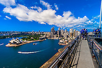 People climbing to the top of the Sydney Harbour Bridge to see the unparalled view of Sydney and it's harbor, BridgeClimb Sydney, Sydney, New South Wales, Australia