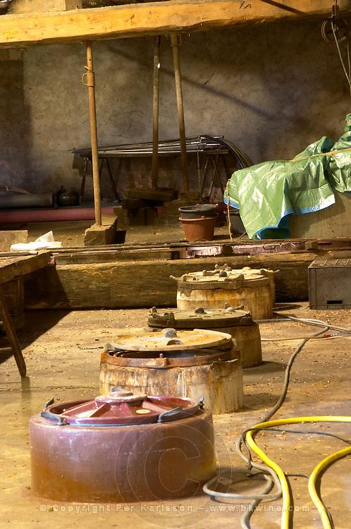 Chateau Pech-Redon. La Clape. Languedoc. Concrete fermentation and storage vats. France. Europe.