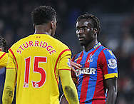 Liverpool Daniel Sturridge argues with Crystal Palace Pape N'Diaye Souare during the The FA Cup 5th Round match between Crystal Palace and Liverpool at Selhurst Park, London, England on 14 February 2015. Photo by Phil Duncan.