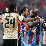 Trabzonspor's Deguy Alain Didier ZOKORA (R) during their UEFA Champions League third qualifying round, second leg, soccer match Trabzonspor between Benfica at the Ataturk Olimpiyat Stadium at İstanbul Turkey on Wednesday, 03 August 2011. Photo by TURKPIX