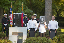 September 11, 2016 - Lejeune, North Carolina, U.S. - Members of the Onslow Civic Affairs Committee hold photos of those killed in the 9/11 terror attacks during a remembrance ceremony commemorating the 15th anniversary at the Lejeune Memorial Gardens. (Credit Image: © Cpl. Austin M. Schlosser/Planet Pix via ZUMA Wire)