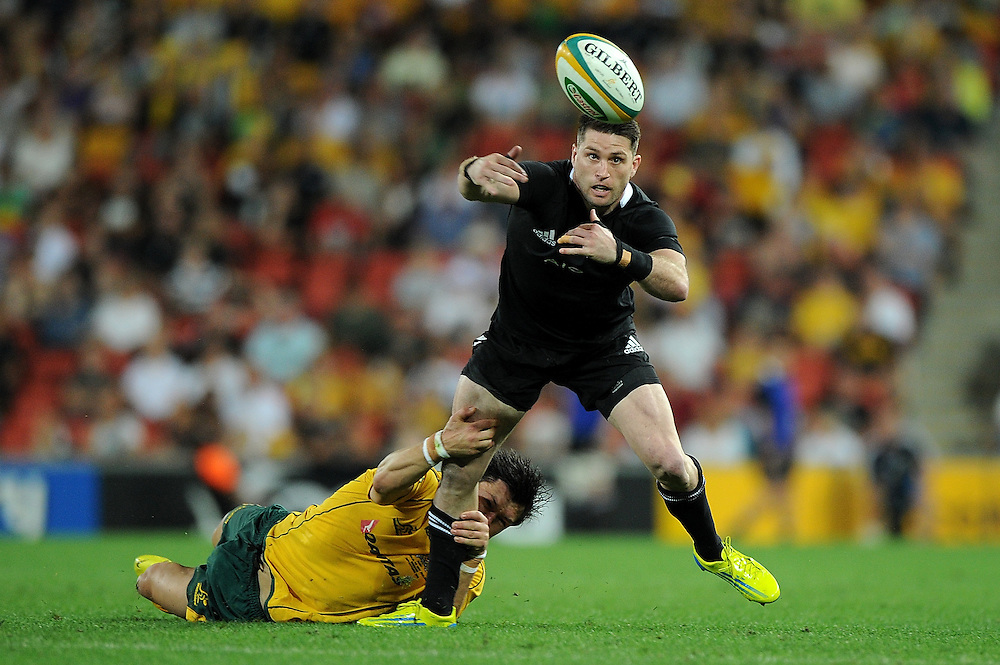 BRISBANE, AUSTRALIA - OCTOBER 20:  Cory Jane of the All Blacks looses the ball in the tackle during the Bledisloe Cup match between the Australian Wallabies and the New Zealand All Blacks at Suncorp Stadium on October 20, 2012 in Brisbane, Australia.  (Photo by Matt Roberts/Getty Images)