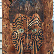 A wood carving at the carved contemporary entrance to Te Puia, Rotorua. Te Puia is the premier Maori cultural centre in New Zealand - a place of gushing waters, steaming vents, boiling mud pools and spectacular geysers. Te Puia also hosts National Carving and Weaving Schools and  daily maori culture performances including dancing and singing. Rotorua, 8th December 2010 New Zealand.  Photo Tim Clayton