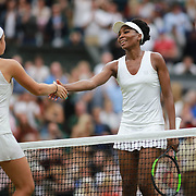 LONDON, ENGLAND - JULY 11:  Venus Williams of the United States is congratulated on her victory by Jelena Ostapenko of Latvia in the Ladies' Singles Quarter Final match on Center Court during the Wimbledon Lawn Tennis Championships at the All England Lawn Tennis and Croquet Club at Wimbledon on July 11, 2017 in London, England. (Photo by Tim Clayton/Corbis via Getty Images)