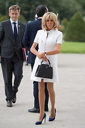 Brigitte Macron, wife of French President, waits outside the Army Museum during a ceremony at Les Invalides in Paris, on July 13, 2017. Donald Trump arrived in Paris for a 24-hour trip that coincides with France's national day and the 100th anniversary of US involvement in World War I. ELIOT BLONDET/ABACAPRESS.COM