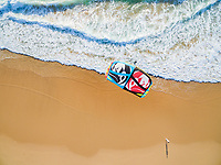 PRAIA DA GUINCHO BEACH, PORTUGAL - MAY 23, 2017: People kitesurfing at popular blue flag Guincho beach.