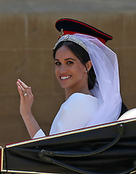 Meghan Markle and Prince Harry ride in an Ascot Landau carriage at Windsor Castle after their wedding.