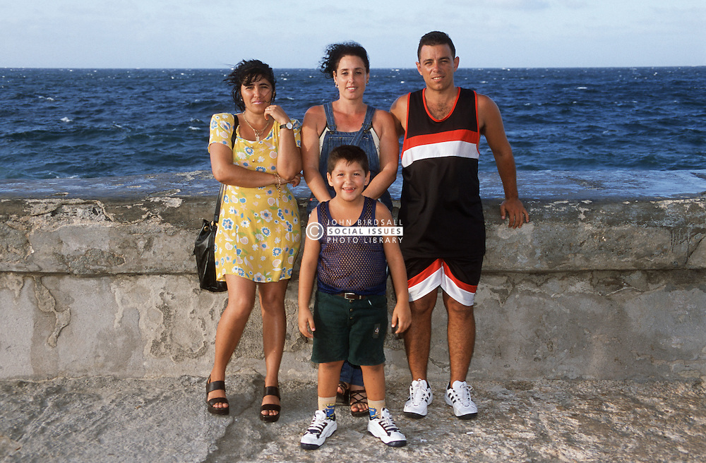 Family group standing on the seafront in Havana  the Malecon,