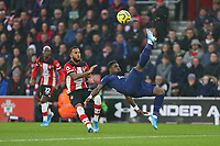 Football - 2019 / 2020 Premier League - Southampton vs. Tottenham Hotspur<br /> <br /> Serge Aurier of Tottenham acrobatically volleys clear from Southampton's Ryan Bertrand during the Premier League match at St Mary's Stadium Southampton <br /> <br /> COLORSPORT/SHAUN BOGGUST